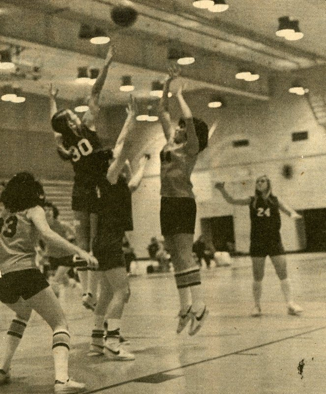 1965 February 27 Pio Log women's basketball Cori Burgess arches a shot over the outstretched arms of a Lane defender.jpg