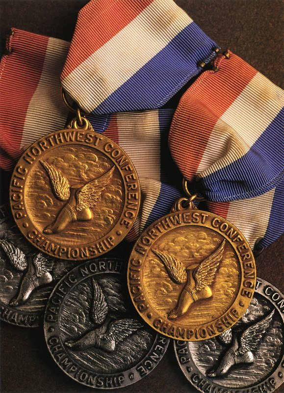 cross county and track medals.jpg