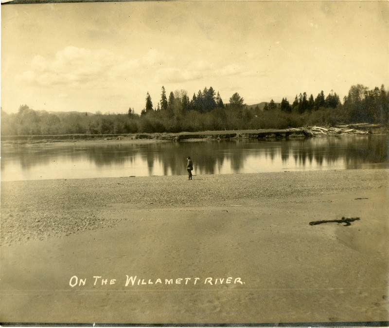 A man standing on the banks of the Willamette river.
