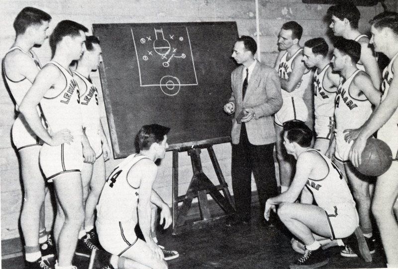 1949 Voyageur varsity basketball team strategizing %22Chalk Talk%22.jpg